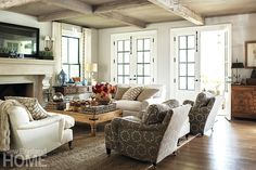 Jane Green's comfortable Westport family room with reclaimed lumber beams & french doors to garden