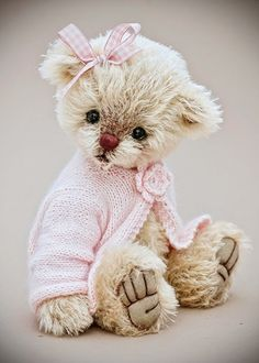 This adorable teddy, Chloe, is from Three O'Clock Bears.  She's been adopted, but there are other darling choices there.