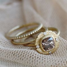 Regal flower ring featuring a brown cushion cut diamond with stacking rings ~ we ❤ this! moncheribridals.com