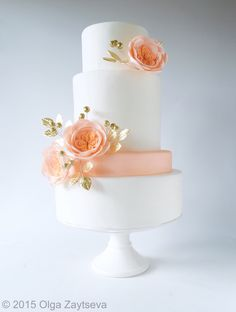 Clean and simple four tier modern white wedding cake with peach English roses and gold-plated leaves by Olga Zaytseva