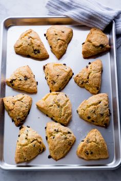 Scones, buttery baked biscuit-like treats, are a great menu item for fancy breakfast or formal high-tea, but they're also lovely for a casual party, brunch, or other get together. They're SO EASY - one of my favorite easy baking recipes. Get the How To steps and make a batch today!