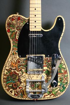 Nice guitar art designs, handmade guitar paintings and engravings made by Swedish artist Jesper Erikson .
