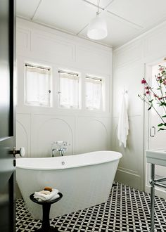 iris soaking tub, floor tile and wall patterns :  The Renovation was Overdue from nytimes.com