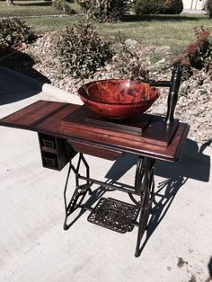 Antique treadle sewing machine repurposed to Vessel Sink