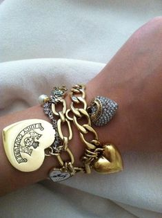I have one I just started with two charms. I love it! Juicy Couture :)