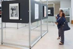 Two people standing and looking at a picture