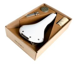 For over 140 years, Brooks England has built a solid reputation making quality leather saddles and bags. The Wilson Brothers have teamed up with Brooks to produce a solid white version of the sleek Swallow saddle noted for its excellent construction and craftsmanship. #stussy.com