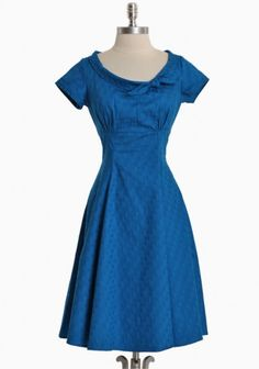 Shopruche.com...Vibrant blue cotton dress features a classic silhouette with a subtle polka dot pattern and a back zipper closure. $104