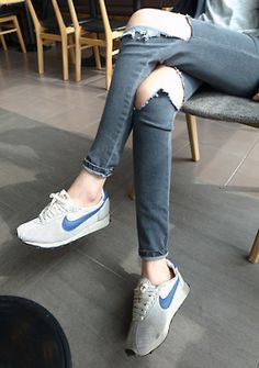 ripped jeans and Nike sneakers