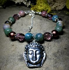 A personal favorite from my Etsy shop https://www.etsy.com/listing/233932664/buddha-charm-bracelet-natural-stone