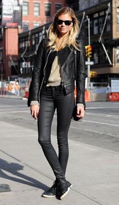 black moto jacket. black skinny jeans. black sneakers. neutral long sleeve top. black ray bans.