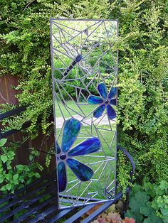 Mosaic garden mirror (31 x 92cm / 1' x 3'). Handmade using stained glass, silvercoated glass, recycled mirror, glass nuggets, wire & bead.