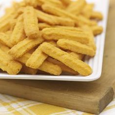 Savory and rich with just a bit of a peppery bite, cheese straws are great party snacks. They're especially easy to make and travel well. Cookie Press, Cheese Bites, Easy Cheese, How To Make Cheese, Onion Rings, Party Snacks, Cheese Straws, Cheese Cookies, How To Make Homemade