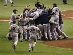Boston Red Sox players celebrate after defeating the Tampa Bay Rays 3-1 to win baseball's American League division series, Tuesday, Oct. 8, 2013, in St. Petersburg, Fla. (AP Photo/John Raoux)