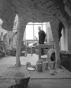 """Sculptor Marino Marini in front of window and framed by one of his horses. Published in """"""""House Beautiful"""" 1971. Photo taken in 1965 with a 35 mm NIkon FM."""