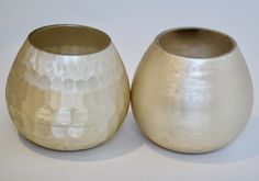 Textured gold bowls are great as bud vases or votive holders.