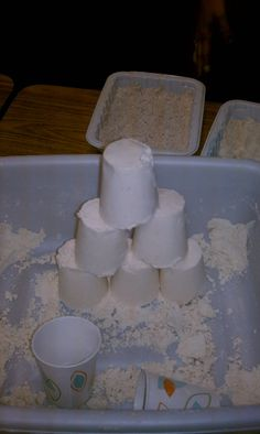 Moon sand! Just 8 cups of flour and 1 cup of baby oil, really soft and easy to clean up.
