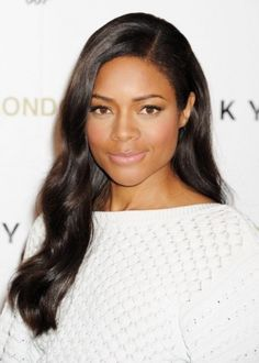 http://www.shorthaircutsforblackwomen.com/brazilian-blowout/ Naomie Harris African American Hairstyle: Smooth, side-swept waves Skyfall actress Naomie Harris looks smoldering hot with her long, side-swept waves of hair. She looks every bit the sexy Bond Girl with her shiny, smooth waves of hair and minimal make-up. Side-swept hairstyles are very popular at the moment, and they are easy to recreate at home.