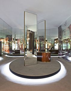 Catwalk tour: the top S/S 2014 women's fashion week venues / Tod's: Different corners of the setting mimicked rooms in a grand home, the central mirrors reflecting the models' outfits from every angle