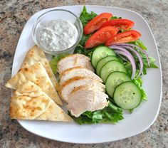 You're gonna love this Chicken Gyro Salad with Creamy Tzatziki Dressing! It's light, flavorful and filling without all the extra added calories.