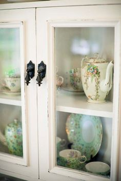 ❥ Vintage Collection in a beautiful antique cabinet~ love the door knobs