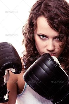 Sport boxer woman in black gloves. Fitness girl training kick boxing. ...  active, aggressive, arts, box, boxer, boxing, competitive, danger, defence, defend, emancipation, exercise, extreme, feminism, fighter, fighting, fit, fitness, force, girl, gloves, gym, hit, isolated, kick, kickboxing, martial, person, power, protection, punch, self, sport, strength, strong, training, white, woman, workout