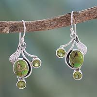 Discover unique handcrafted treasures. Every purchase will help UNICEF save and improve children's lives and help support talented artisans. Peridot dangle earrings, 'Dew Blossom'
