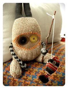 It's a toss-up between this one and the owl. I love the accessories that she makes like fishing poles and scarves. Sock Monster, Monster Dolls, Zombie Dolls, Dou Dou, Softie Pattern, Sock Toys, Sock Crafts, Sock Animals, Knitted Dolls