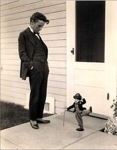 charlie chaplin - if only he was doing the same thing as the doll. lol.
