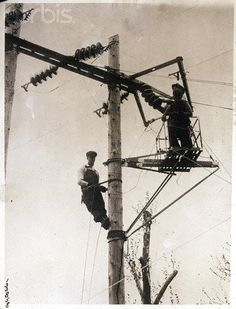 Original caption: IL- Handling volts of electricity, Chicago linemen work on power wires barehanded, while standing on a specially insulated wooden platform. Lineman Wife, Power Lineman, History Of Electricity, Electrical Lineman, Journeyman Lineman, Line Love, Power Wire, Vintage Tools, High Voltage