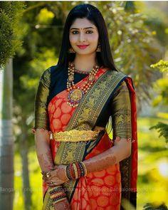 South Indian bride. Gold Indian bridal jewelry.Temple jewelry. Jhumkis.Red silk kanchipuram sari. Braid with fresh flowers. Tamil bride. Telugu bride. Kannada bride. Hindu bride. Malayalee bride.Kerala bride.South Indian wedding. Pinterest: @deepa8