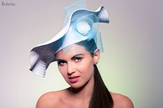Turquoise-white straw hat with light blue veil and flower