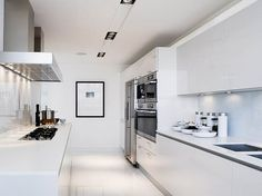 modern white gloss cabinets, kitchen, gas cooktop,