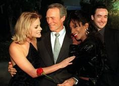 """""""Midnight in the Garden of Good and Evil"""" director Clint Eastwood is flanked by his daughter Alison Eastwood, left, and The Lady Chablis, both of whom star with John Cusack, right, in the Warner Bros. film at its premiere on Nov. 17, 1997, in Burbank, Calif. John Hayes / AP file  From Sept 8, 2016, NBC News report on death of Lady Chablis."""