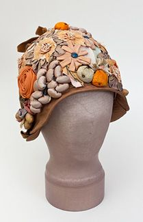 Ribbon-work just does it for me... Embellished straw cloche hat, circa 1923.