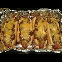 Absolute keeper! Best Chili Dog EVER. Oven Baked Chili Dogs:  8 quality hot dogs (I use Ballpark beef dogs for these),  8 hot dog buns,  1 can chili WITH beans,   1/2 an onion, grated  Grated Cheddar, Mayonnaise (NOT optional, it does something amazing to the bread),  mustard, dill.  Line inside of hot dog buns with mayonnaise and dill. Evenly add mustard. Fill with hot dogs and squish into a 13×9″ baking pan (7 w/quality brat buns).  Cover with aluminum foil and bake at 350 F for 45…