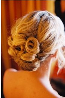 Lower wedding updo with rolls and long side bangs. I think I'd rather have something like this with the side, fish-tail braid and bangs pinned to the side.