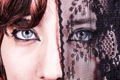 The deep blue eye veiled