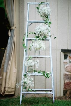 Charm abounds on a white-washed ladder with twirling ivy and babies-breath filled mason jars at Lyndsay and Dan's Audubon wedding - by Buttercup: Off BEET Productions Photography.