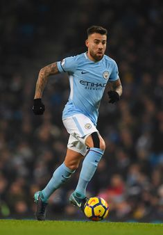City player Nicolas Otamendi in action during the Premier League match between Manchester City and Newcastle United at Etihad Stadium on January 20, 2018 in Manchester, England. - 145 of 178