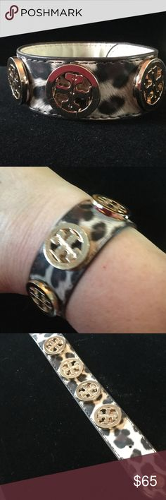 Tory Burch Rare Leopard Bracelet This is a highly sought after Tory Burch bracelet.  Four beautiful bold iconic Tory Burch insignias !  Fits small through large wrists due to two sturdy snaps inside.  Looks and feels like leather ,  I don't know for sure. Excellent condition Tory Burch Jewelry Bracelets