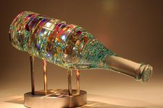 Exclusive Cold Glass Sculptures by Glass Sculptor Jack Storms. Pure, lead crystal and dichroic glass combined through a cold-glass production process.