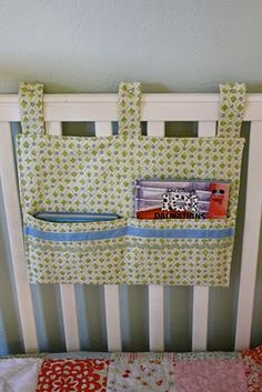 here is a quick tutorial for a little hangy thingy for your child's crib...fill it with books, toys, or binkies to keep them happy after naps. (or before...)