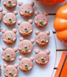 Halloween Bear Macarons holding onto their Jack O Lanterns  easy Chocolate macaron recipe on Indulge with Mimi