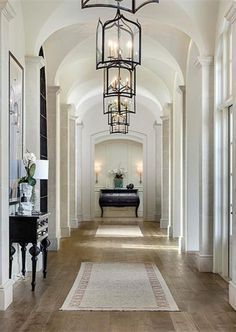 Living With Art | Elegant art gallery walkway with groin vault ceilings | Sotheby's