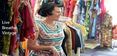 Lisa in vintage dress surounded by vintage dresses inside Atomic Martini Vintage in Clayfield Brisbane Shopping, Martini, Vintage Shops, Vintage Dresses, Kimono Top, Cover Up, Vintage Fashion, Sari, Blouse