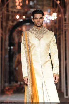 Sherwani with a gold nech design and a dark yellow dhoti #asianweddingmag #asianweddingshow #asianwedding #asiangroom #sherwani