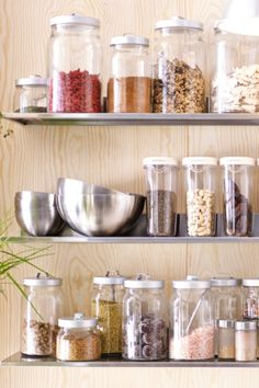 One of the most important items in a raw food kitchen is storage containers. IKEA glass and plastic containers work great for helping your staple ingredients like nuts, seeds and spices stay fresh longer. We like the idea of using open shelves to keep it all close to hand.