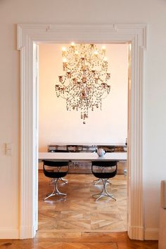 Luxurious dining space with giant crystal chandelier
