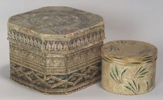 "Two Wallpaper Covered Boxes, America, early to mid-19th century, an octagonal-sided box centered with a medallion on the cover, the sides with three leafy and geometric borderes, in shades of red, blue, green, brown, and black, the interior cover with penciled inscription ""Made and Sold By John Laurenez March the 6 1820""; the other box round, covered with white, green, and black stylized leaf designs on a creamy yellow ground, (wear, fading), ht. 5 3/4, 3 1/2, dia. 8 3/4, 5 in."